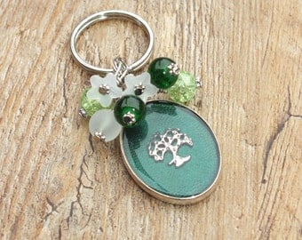 Silver Tone Forest Green Oval Shaped Nature Natural Tree Themed Keyring with Crackle Glass Frosted Glass and Lucite Flower Beads