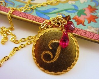 J initial necklace. Bright gold. Red and chocolate brown glass bead cluster. Medallion necklace with Swarovski beads.