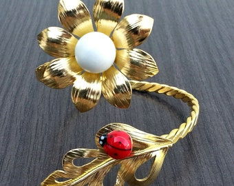 Daisy and ladybug cuff, bracelet, gold plated flower and lampwork bead