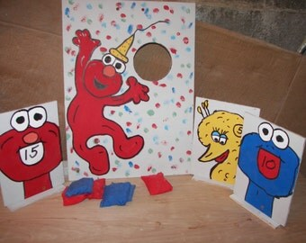 2  games 1 elmo  and   1  set  of  kniock overs   with  8  bean  bagswith cofetti  background