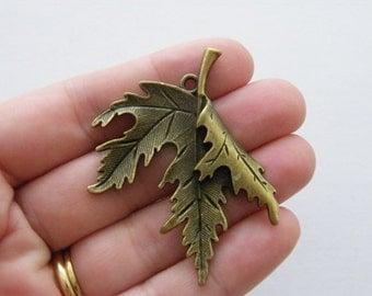 2 Leaf charms antique bronze tone BC113