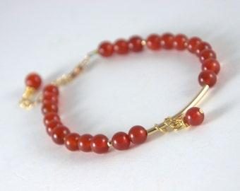 Carnelian and gold bracelet, tube bead, red, beaded bracelet, dangle, wrapped bead