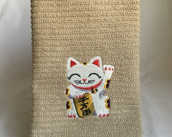 Embroidered good luck neko cat on sand colored horizontal bar towel