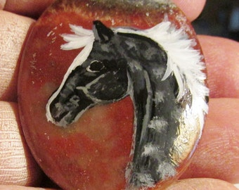 Painted gray horse gemstone pendant on reddish-brown and black