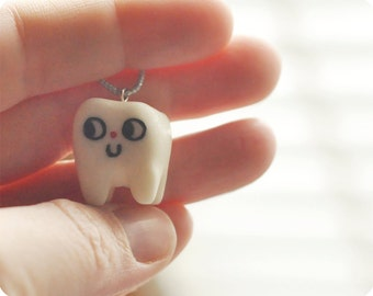 Smiling Tooth necklace cold porcelain clay