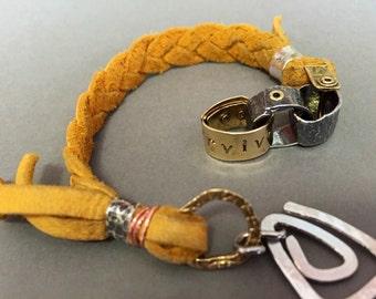 Survivor bracelet -:- Riveted survivor link & leather bracelet.