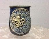Octopus Mug with fish background.