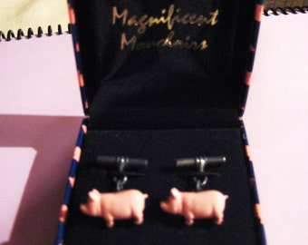 Pink pig cuff links in box