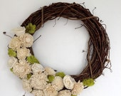 Grapevine and sola wreath