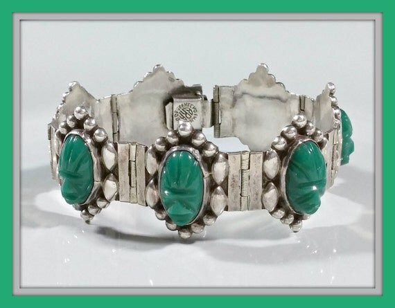 1950s Costume Jewelry 1950s Mid Century Mexico Silver Bracelet Panel Style Carved Masks Green Onyx Chalcedony Nicely Crafted Outstanding Piece Depicting Ancient People $89.00 AT vintagedancer.com