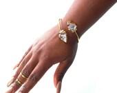 Brass statement cuff- cowrie and amethyst bracelet- triple strand bracelet