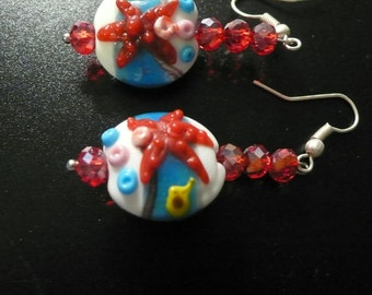 white, yellow, blue and red starfish lampwork bead pierced earrings