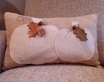Decorative burlap pillow with vintage canvas pumpkins, wool leaves and vintage buttons