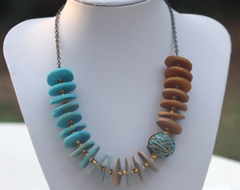 Gradual colored necklace in gold, beige and turquoise, polymer clay