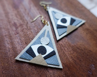 hand cut desert inspired southwestern x modern x geometric triangular in neutrals x polyurethane earrings.
