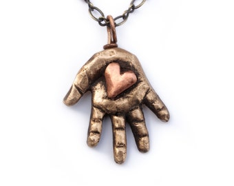 Heart in hand initial necklace