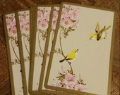 Yellow birds on pink flowering branch Playing Cards