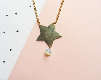 star bright -long pendant (gold tone star charm with a translucent milky hued bead)