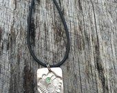 Green eyed fish pendant in Finesilver