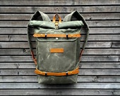 Waxed canvas rucksack/backpack with roll up top and waxed canvas shoulderstraps