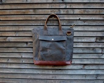 briefcase in waxed filter twill with outside pocket, leather bottom and handles, with shoulder strap   COLLECTION UNISEX