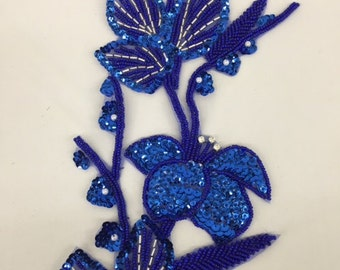 Large sequined flower and stem applique with rhinestones