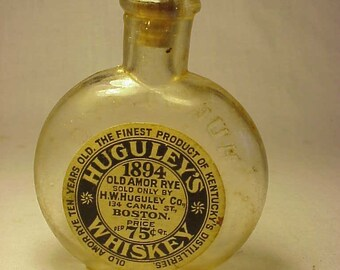 c1900 Huguley's 1894 Old Amor Rye Whiskey H. W. Huguley Company Boston, Mass., Rare Sample Pumpkin Seed Flask with the Original Paper Label