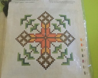 Star cross stitch made by BMB company in Norway. This is a pattern for a cushion cover measuring 35 cm x 35 cm.