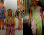 1992 Cross Bodice Shaped Waist Jumpsuit or Jumper Pattern Simplicity 7771 Girls' 5-6-6X. Retro TIE-BACK JUMPSUIT Pattern at WhiletheCatNaps