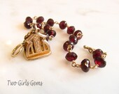Garnet gemstone bracelet with antique fob charm, Two Girls Gems
