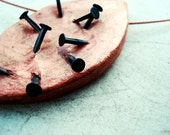 angst, clay pendant with black oxidize d iron nails, leaf shape ooak steel wire