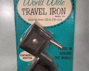 GE World Wide TRAVEL IRON Continental Adaptor Vintage Plugs In Around The World British Adaptor General Electric kitschy gadget
