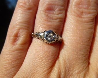 One of a kind  14KT White gold  filigree with a diamond  Engagment Ring