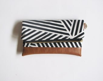 Black and white geometric striped clutch with brown faux leather