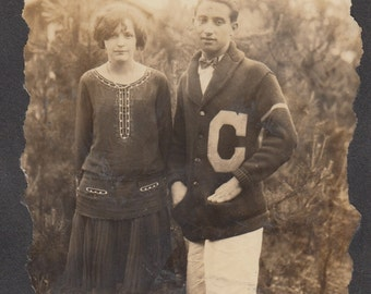 Vintage/Antique photo of a couple in a dress and a college sweater