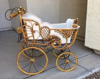 Baby doll buggy vintage Victorian style wicker rattan wood wheels gilt ball trim elegant baby carriage pram