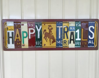 Happy Trails License Plate Sign with Bronc Rider