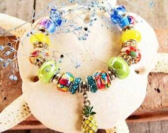 Hawaiian Luau Charm Bracelet with Euro-style Beads and Pineapple Charm  #beachjewelry #springsummer #beach bracelet