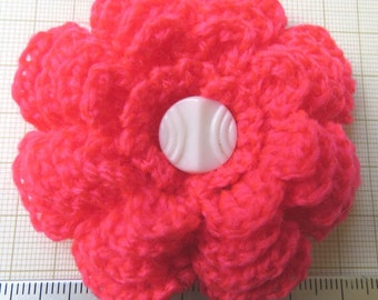 Irish crochet flower brooch in neon pink wool with vintage glass button centre