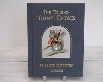 Squirrel Timmy Tiptoes book clock.  Beatrix Potter tale.