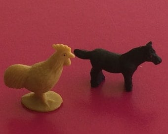 Miniature plastic farm animals, chicken and horse