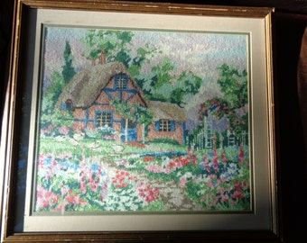 Vintage Needlepoint Landscape Scene of A Thatched Roof Cottage with a wonderful garden and sheep in the meadow in Near Mint Condition
