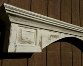 Distressed arch Raised panel fireplace mantel