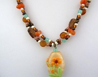 handmade lampwork necklace, orange flower beads jewellery UK