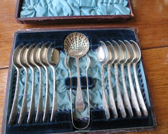 13 piece boxed silver plated ornate teaspoon set