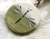 Dragonfly design ceramic pendant necklace in pretty spring green with silk band . Valentines day gift.