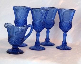 Cobalt Blue Fostoria Collection of Goblets and Pitcher. Avon Bi-Centennial Collection 1976.