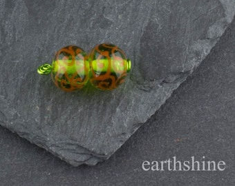 Green and orange handmade lampwork glass beads. Earring pair.