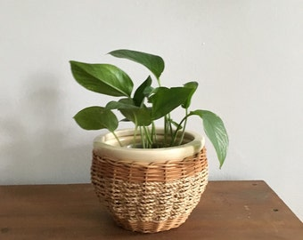 small ceramic planter with woven rattan. mid century woven planter. boho bamboo basket planter. ceramic pot interior design home decor
