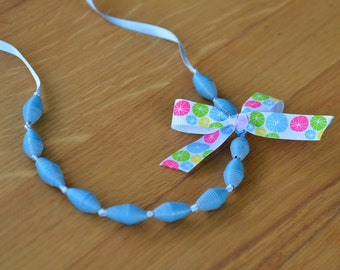 Light blue paper bead necklace on satin ribbon with bow